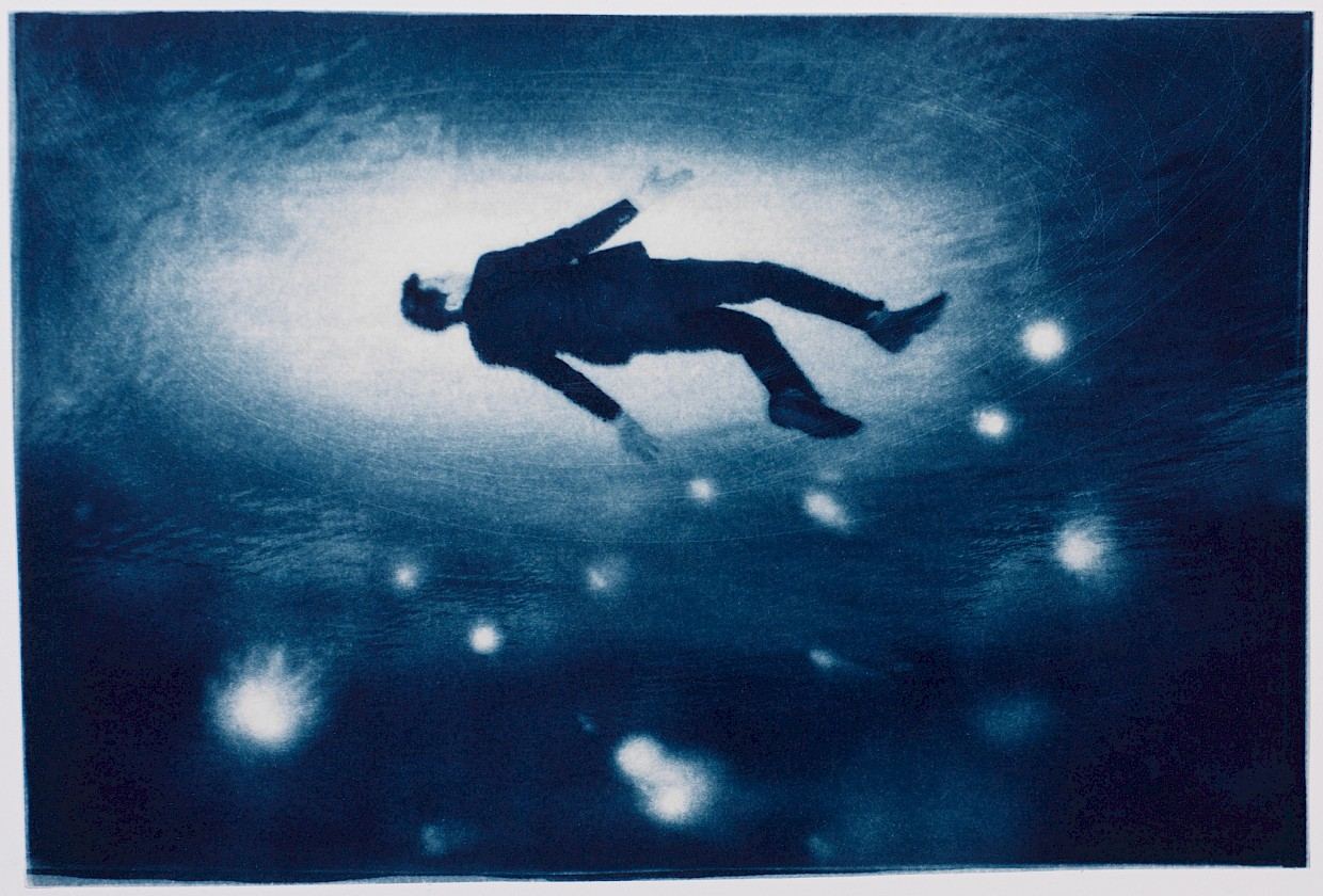 man surfacing from underneath the ocean with strange lights around him suggesting rebirth and renewal