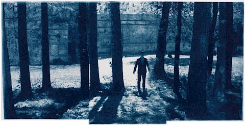 man entering a deep dark forest and there is no path