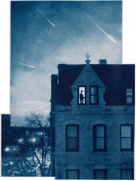 man seen through window of row house against backdrop of light streaks in evening sky