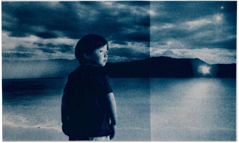 boy in a surreal beach scene looking back