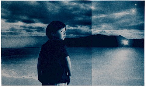 boy in a surreal beach scene looking back