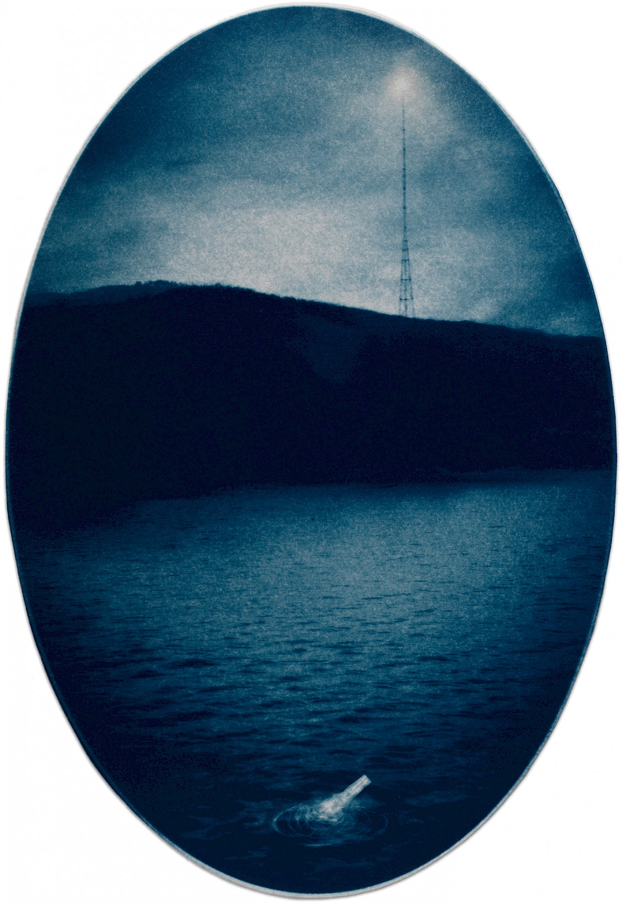 surreal image of message in a bottle with broadcast tower in the background