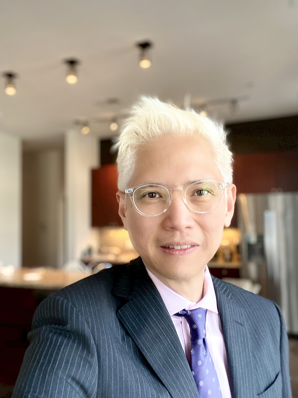 asian man with platinum blonde hair