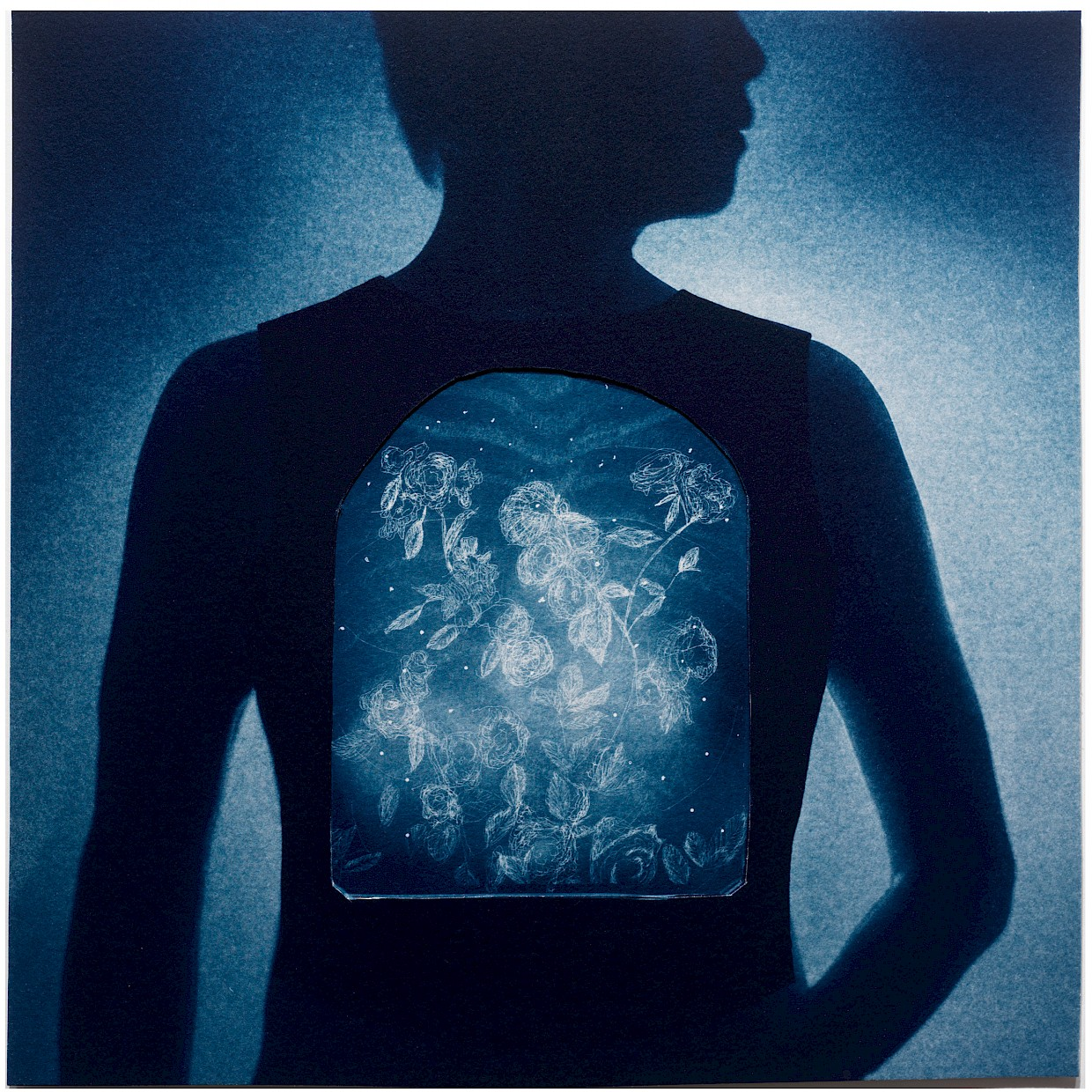 cyanotype print illustration of x-ray of man's interior chest with flowers surreal