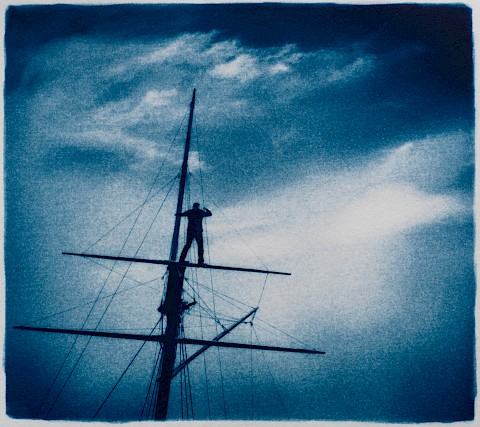 surreal man on mast of ship looking at blue horizon unknown ocean